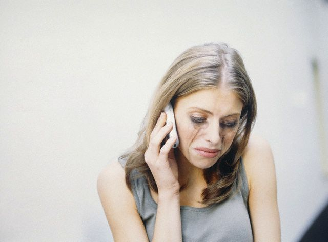 Young woman with covered make-up, calling with mobile phone