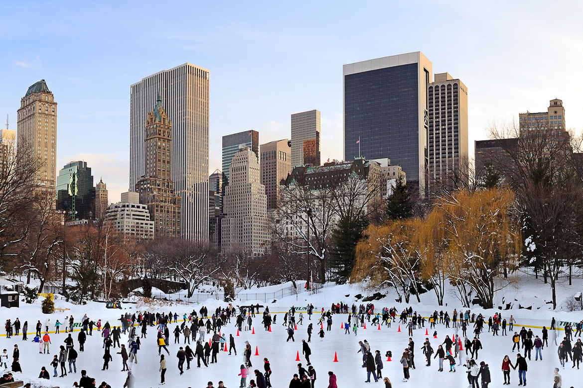 NEW YORK CITY, NY - JAN 1: People skate on ice with white Christ
