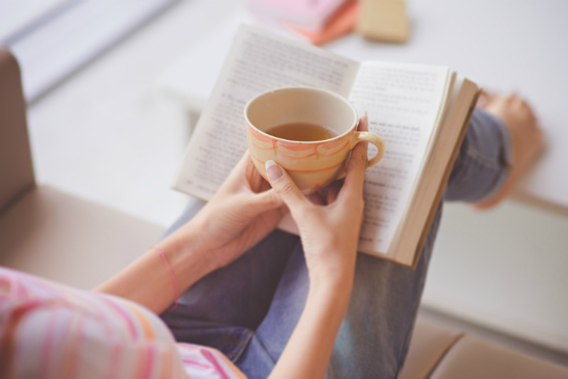 relaxing-with-cup-of-tea-and-book
