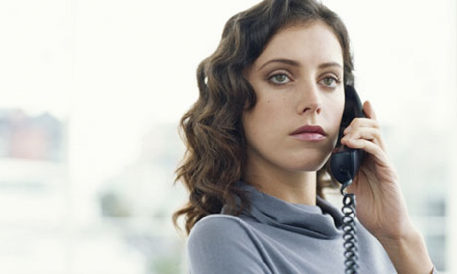 Young woman talks on phone