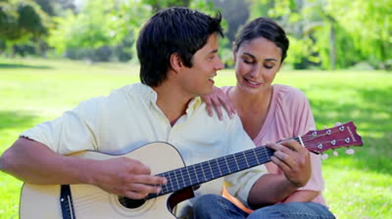 stock-footage-smiling-couple-singing-together-in-the-countryside