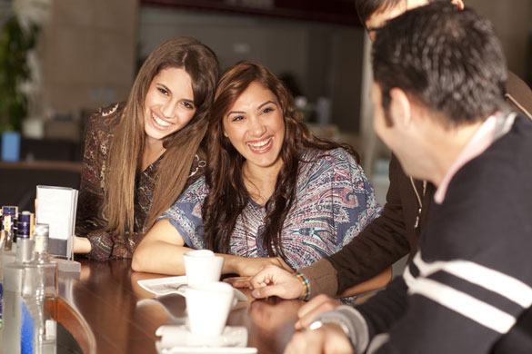 Two-beautiful-young-women-flirting-with-two-men-in-the-bar